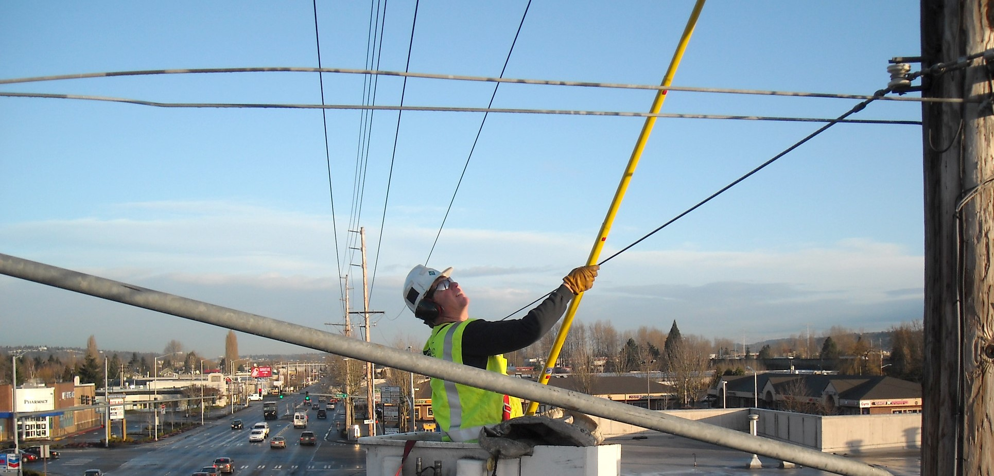 A PSE employee works on some transmission and distribution wires.